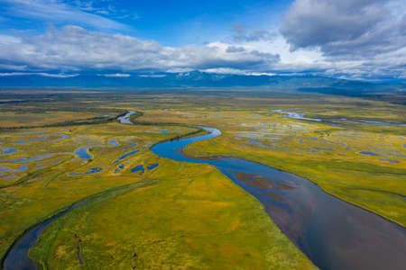Aerial view of Avacha river delta and hilly landscape, Kamchatka Peninsula, Russia