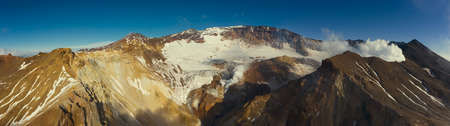 Aerial panorama of crater with fumaroles of active Mutnovsky volcano, Kamchatka, Russia