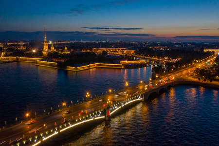 Aerial view of Peter and Paul Fortress and Troitskiy bridge after sunset, Saint-Petersburg, Russia