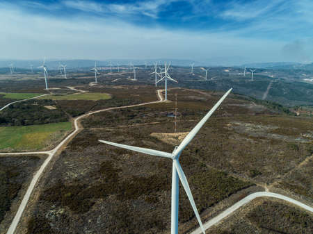 Aerial view of lot of windmills or wind turbine on wind farm in rotation to generate electricity energy Reklamní fotografie