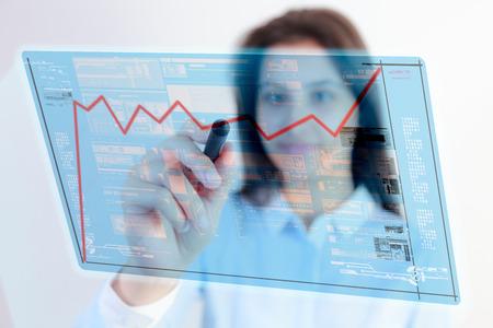 Woman pen touch chart data photo