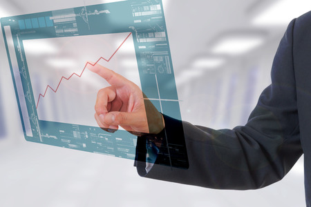 Businessman touching screen photo