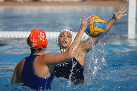 waterpolo: Waterpolo competition. CN Mataro VS Zaragoza. Mataro, Spain. October 18, 2014. White cap team Mataro. Orange cap team Zaragoza Editorial