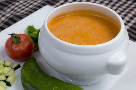 spanish style: Gazpacho. Spanish style soup made from tomatoes and other vegetables and spices, served cold. Stock Photo