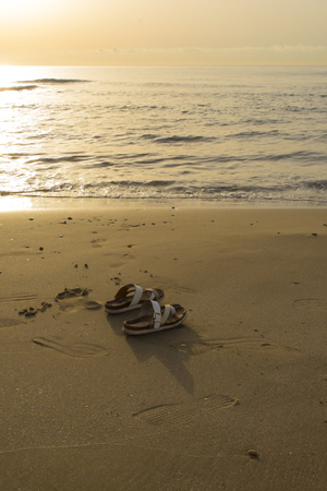 thongs: Sunset on the beach and thongs