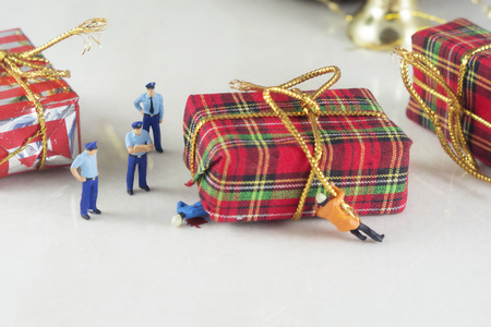 Mini police and accident with Christmas gift