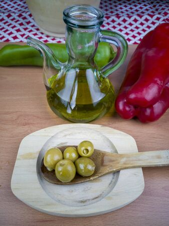 Spanish olives with virgin olive oil Stock Photo - 131366739