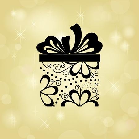 Caja de regalo sobre fondo de oro. Su texto puede ser colocado por debajo de