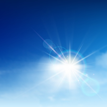 sky: Bright blue sky with easy clouds and solar patch of light