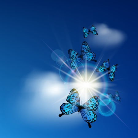Blue butterflies flying against the solar sky