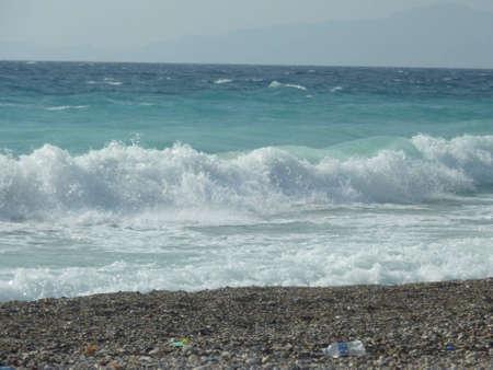 turquise: Waves hits shore