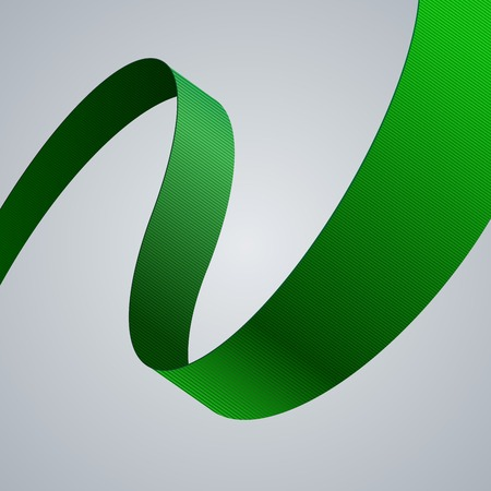 background swirl: Green fabric curved ribbon on grey background.