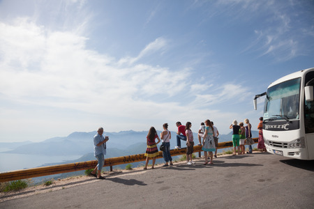 admiring: The tour group is admiring the surrounding area of Kotor Bay. Montenegro