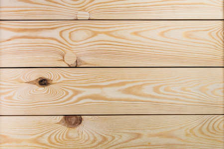 Unpainted pine wood planks with knots. Wood plank texture for your background.