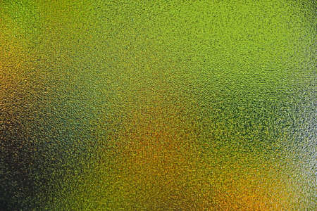Abstract defocused background of colors in translucent glass