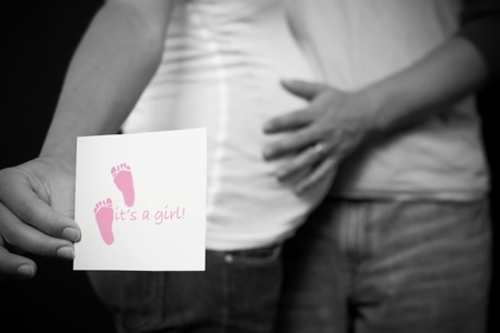 A black and white pregnant couple expecting a baby girl. Stock Photo - 8279830