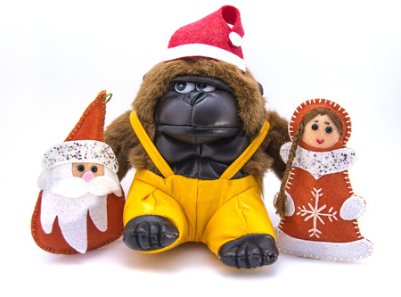 moroz: Monkey in Christmas hat, along with Ded Moroz and Snegurochka. Stock Photo