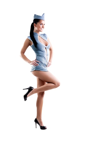 sexy stewardess in blue uniform isolated in white background  Reklamní fotografie