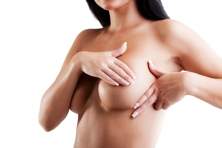 nude breasts: Female controlling breast for cancer