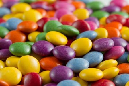 coated: sweet candies spreading pastry decoration background