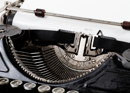 old great amazing typewriter closeup shot on white background photo