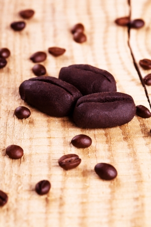 Chocolate coffe beans sweets on wooden background Reklamní fotografie
