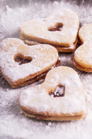 Christmas heart cakes on metal plate photo