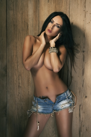 nude breast: Beautiful fit sexy topless woman in blue jeans