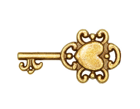 antique golden door key isolated on white background photo