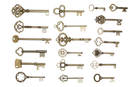 antique golden door keys isolated on white background photo