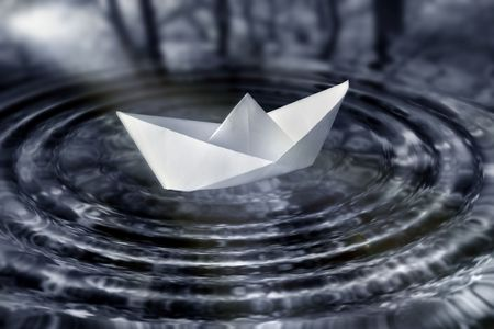 Paperboat in water photo