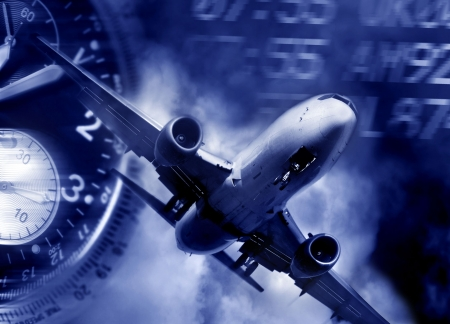 transport concept. Jet aircraft, airport arrival times and a watch Stock Photo - 477510