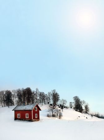 Wooden house with tree and lot of snow around in warm sun Stock Photo - 704253