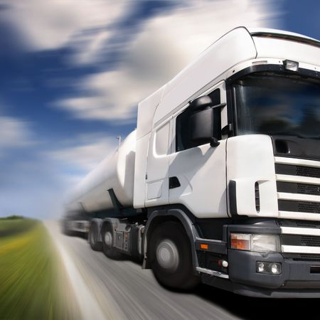haulage: truck driving on country-roadmotion blur