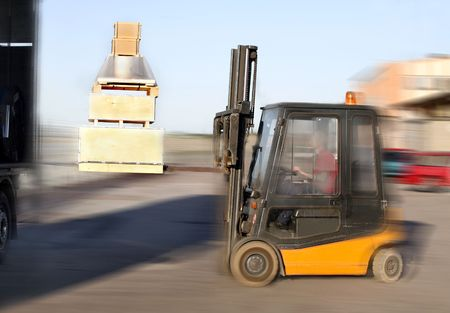 Forklift loading truck photo