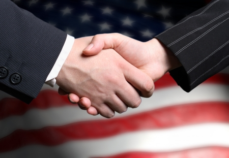 hand shake and a American flag photo
