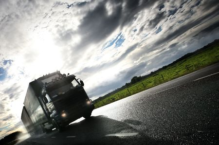 truck driving on country-road/motion Standard-Bild