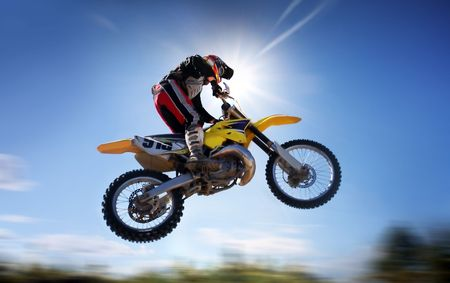 motorcycle wheel: motocross rider in the air
