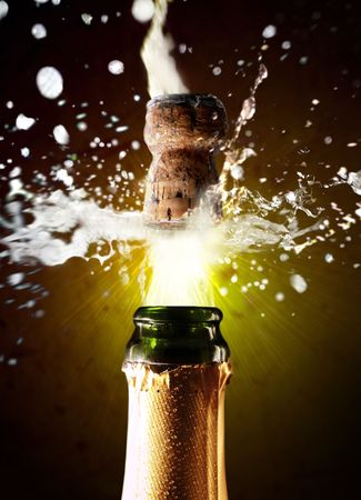 popping the cork: Close up of champagne cork popping