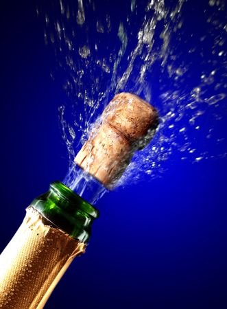 popping: Close up of champagne cork popping