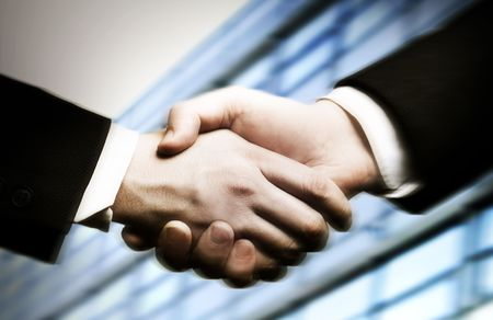 business hand shake and a office in background Stock Photo - 2868605