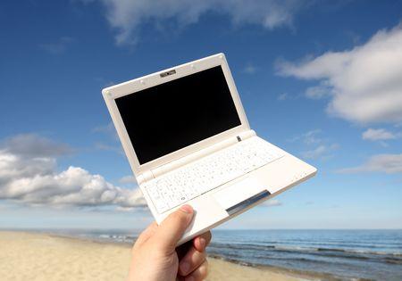 White small  Laptop on the beach Stock Photo - 3441082