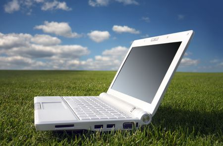 white laptop in nature photo