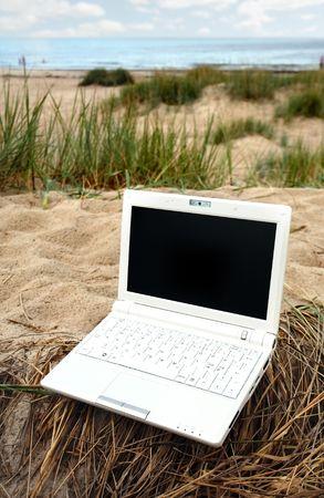 White small Laptop on the beach Stock Photo - 3475242