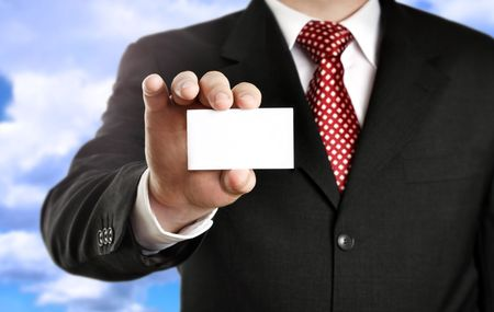 business card in hand: Businessman showing his business card, focus on fingers and card.