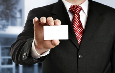 Businessman showing his business card, focus on fingers and card. Stock Photo - 3574816