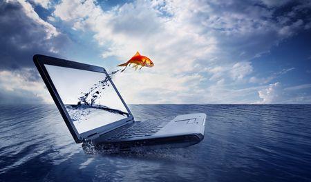 huir: Goldfish saltar del monitor en el oc�ano