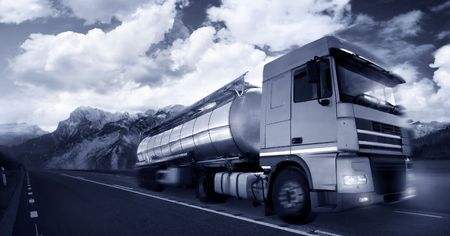 haulage: ruck driving at duskmotion blur Stock Photo