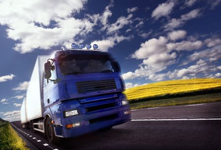 logistic: truck driving at duskmotion blur Stock Photo