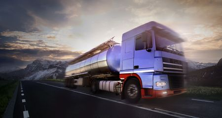 haulage: truck driving at duskmotion blur Stock Photo